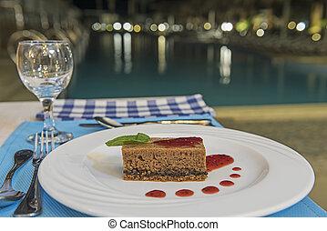 Chocolate sponge cake dessert in luxury a la carte restaurant