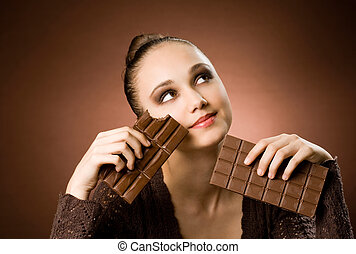 Portrait of a striking brunette beauty enjoying chocolate desserts