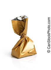 Chocolate sweet in golden foil on a white background