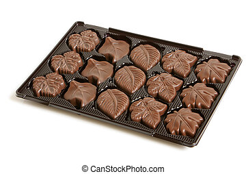 Chocolate sweets in a box on a white background