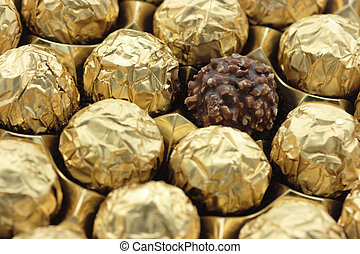 Chocolate sweets in golden foil