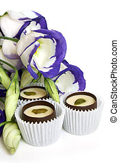 Chocolate sweets with flowers (lisianthus)