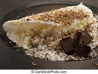 Brazilian food. Tapioca with coconut and chocolate