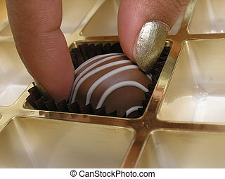 Chocolate temptation - Taking the last chocolate in the box.