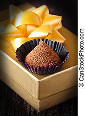 Chocolate truffle. - Homemade chocolate truffle in a paper...