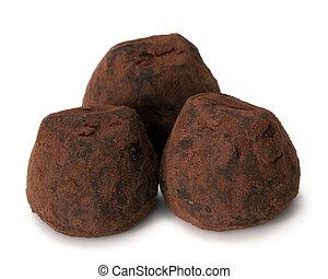 chocolate truffle over white background