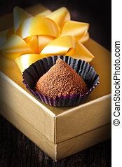 Chocolate truffle. - Homemade chocolate truffle in a paper...