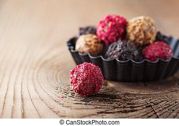 Chocolate truffles - Assorted dark chocolate truffles with ...