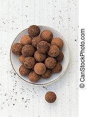 Chocolate truffles. Chocolate truffles with cocoa powder