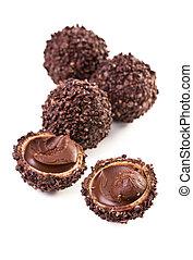 chocolate truffles on white background