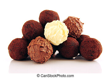 Chocolate truffles - Pile of assorted chocolate truffles ...