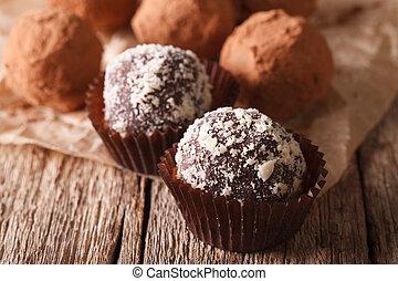 Chocolate truffles sprinkled with nuts macro. horizontal -...