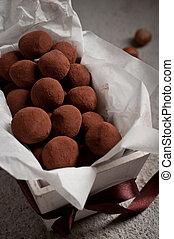 truffles of slightly bitter chocolate with hazelnut center