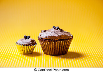 Chocolate velvet cupcake with buttercream topping and one...