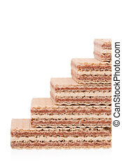Chocolate wafers put by a ladder isolated on white ...