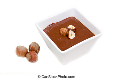Chocolate with hazelnuts on a white background