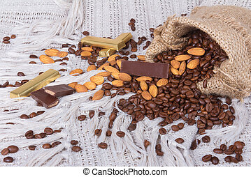 chocolates, Coffee beans and almonds in canvas sack