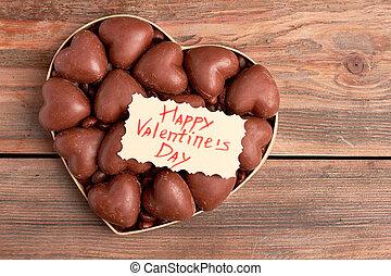 Chocolates in heart-shaped box.