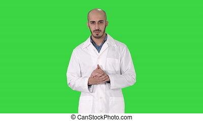 chodząc, spoinowanie, doktor, key., wiek, chroma, jednolity, patrząc, środek, aparat fotograficzny, dłoń, przedstawiając, ręka, zielony, ekran, medyczny człowiek