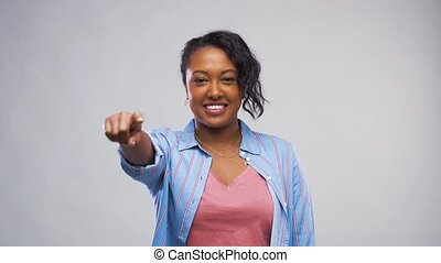 african american woman pointing finger at camera - choice...