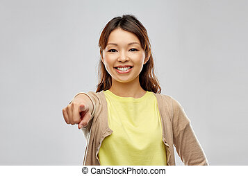 asian woman pointing finger to you