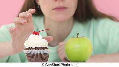 Choice girl between apple cake - Girl longly makes choice...