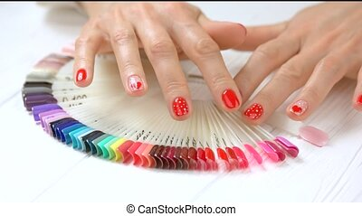 Choice of nail color by female hands. Female hands with...
