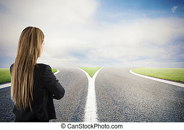 Choices of a businesswoman at a crossroads. Concept of decision