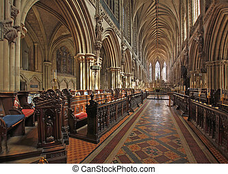 Choir stalls Lichfield Cathedral - Praises to God have been...