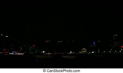 Chonburi Thailand, 2019 October 01, time lapse night sea at pattaya and speed boat parking in gulf and green laser of restuarest