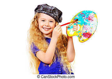 choosing color - Pretty little girl painter posing with a...