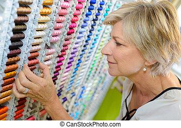 choosing cotton at the haberdashery store