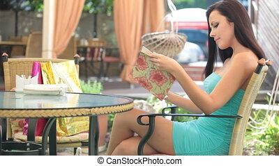 Choosing from menu - Pretty woman choosing from menu in the...