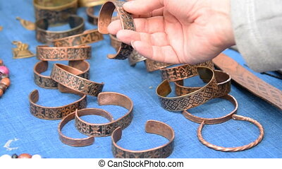 Choosing metal bracelet - Close-up shot of a hand with...