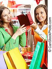Choosing presents - Portrait of two girls choosing gifts in ...