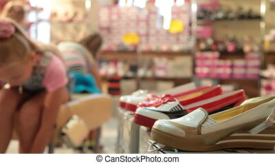Choosing Shoes in Shoe Store