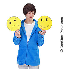 Choosing to be happy - teenager boy with cheerful and sad masks