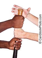 Hands of different races grab a baseball bat