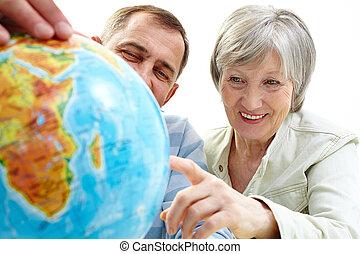 Choosing where to go - Portrait of happy senior couple...