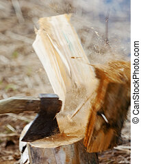 chop firewood for fire in wood