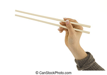 Chop Sticks - Asian hand holding a pair of chop sticks in...