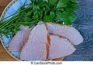 bacon meat with green parsley in a plate