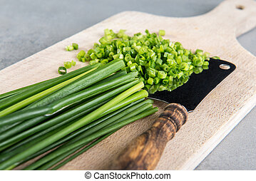 Chopped chives on cutting board