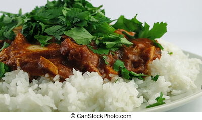 Chopped Coriander Added to Chicken Tikka Masala - Chopped...