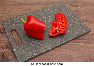 Chopped fresh bellpepper on cutting board on wooden table
