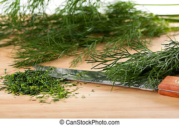 Fresh and green chopped dill on the cutting board