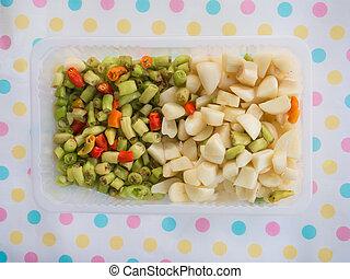 Chopped garlic and guinea pepper in the box