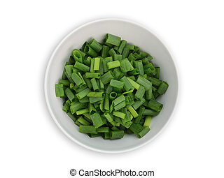 chopped green onions in the white bowl isolated on white background, top view, flat lay