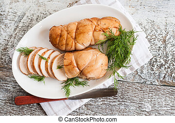 chopped meat fillet baked with herbs on a plate