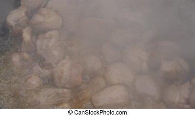 chopped meat fried in big frying pan. Cooking stir-fried...